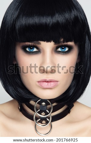 Close-up portrait of young beautiful sexy brunette in black leather collar  - stock photo
