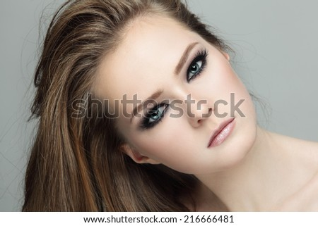 Close-up portrait of young beautiful teen girl with smoky eyes make-up - stock photo