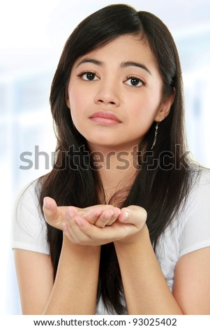 close up portrait of young beautiful woman begging for something - stock photo