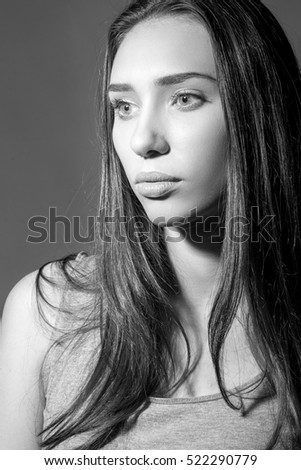 Close-up portrait of young beautiful woman. black and white photo.