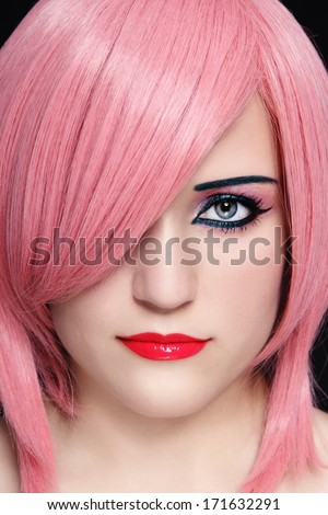 Close-up portrait of young beautiful woman in pink wig - stock photo