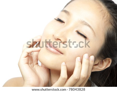 Close up portrait of young beautiful woman's face - stock photo
