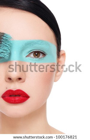 Close-up portrait of young beautiful woman with fancy make-up, on white background