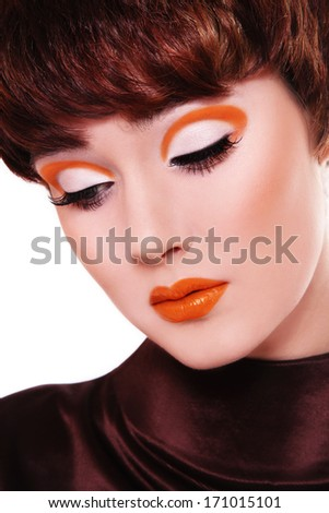 Close-up portrait of young beautiful woman with fancy orange make-up - stock photo
