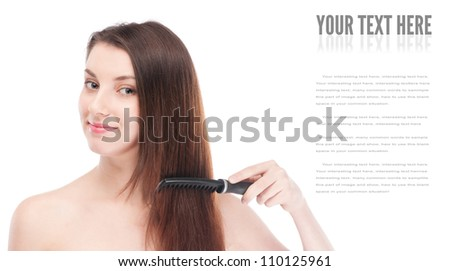 Close-up portrait of young beautiful woman with hair brush - stock photo