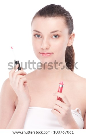 Close-up portrait of young beautiful woman with lipstick brush for make-up. Lips zone - stock photo