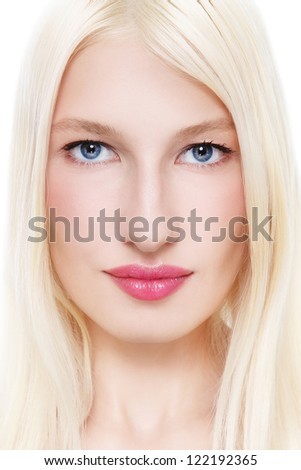 Close-up portrait of young beautiful woman with long blond hair - stock photo