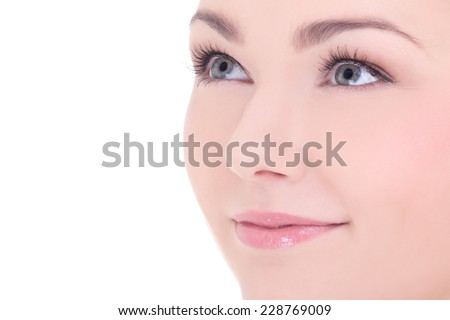 close up portrait of young beautiful woman with long eyelashes isolated on white background - stock photo
