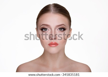 Close up portrait of young beautiful woman with make up on white background