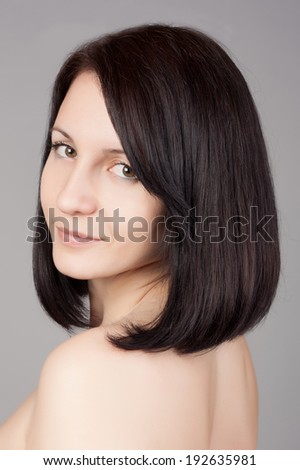 Close-up portrait of young beautiful woman with short hairstyle