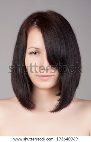 Close-up portrait of young beautiful woman with short hairstyle. Beautiful haircut. Short straight hair. - stock photo
