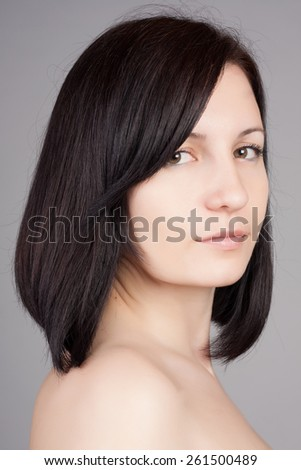 Close-up portrait of young beautiful woman with short hairstyle. Beautiful haircut. Short straight healthy hair. - stock photo