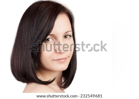 Close-up portrait of young beautiful woman with short hairstyle isolated on white background. Beautiful haircut. Short straight healthy hair.