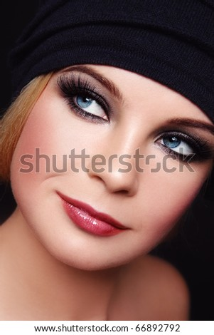 Close-up portrait of young beautiful woman with smoky eyes - stock photo
