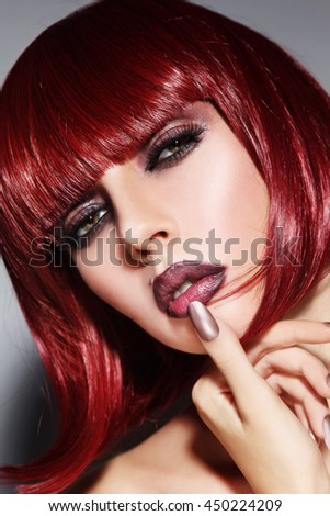 Close-up portrait of young beautiful woman with stylish bob haircut and wet smoky eyes make-up