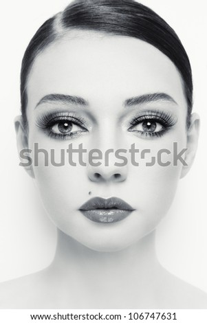Close-up portrait of young beautiful woman with stylish make-up - stock photo