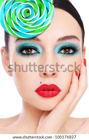 Close-up portrait of young beautiful woman with stylish make-up and fancy hat