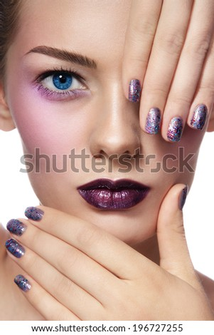 Close-up portrait of young beautiful woman with stylish make-up and glitter manicure - stock photo