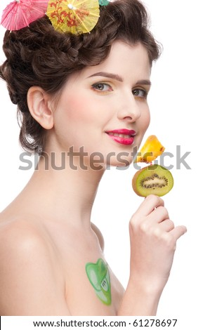 Close up portrait of young beauty woman with fruit bodyart and fruit canape of orange and kiwi.  Isolated on white.