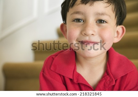 Close up portrait of young boy - stock photo
