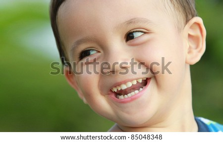 close up portrait of young boy smiling - stock photo