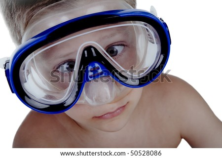 Close-up portrait of young boy wearing snorkel mask, studio shot isolated on white background - stock photo