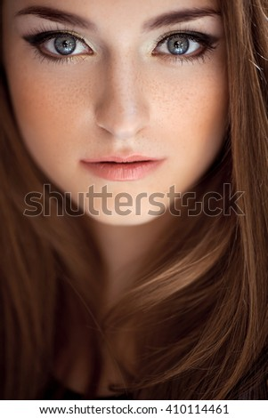 Close-up portrait of young brunette lady in black dress posing  - stock photo