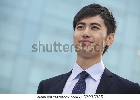 Close-up portrait of young businessman, China - stock photo