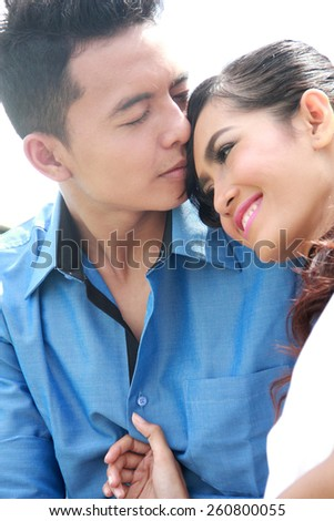 close up portrait of young couple in love - stock photo