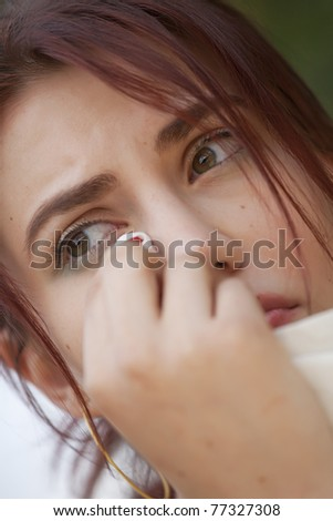 close-up portrait of young crying woman