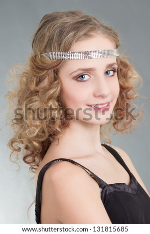 close up portrait of young curly woman over grey background - stock photo