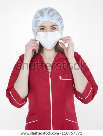 close up portrait of young doctor in mask - stock photo