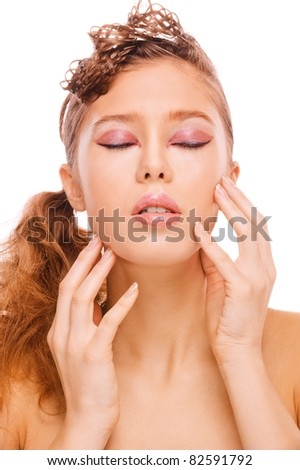 Close-up portrait of young fair-haired beautiful woman with eyes closed against white background. - stock photo