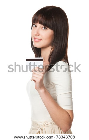 Close-up portrait of young female holding credit card isolated on white background - stock photo
