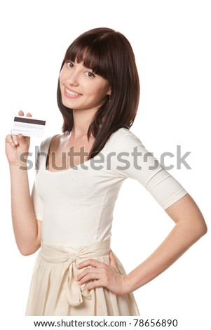 Close-up portrait of young female holding credit card isolated on white background