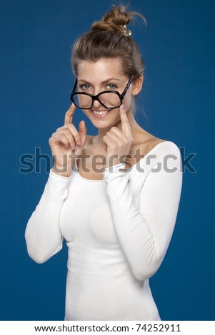 Close-up portrait of young female in old fashioned eyeglasses looking at the camera - stock photo