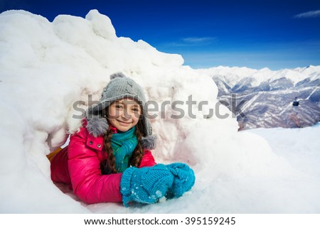 Close up portrait of young girl playing in snow