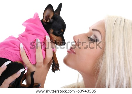 close-up portrait of young glamorous woman with toy-terrier over white background