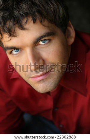 Close-up portrait of young good looking man - stock photo
