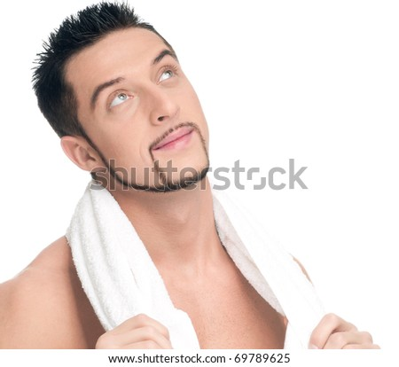 Close up portrait of young handsome dream man with perfect skin and towel. Isolated on white - stock photo