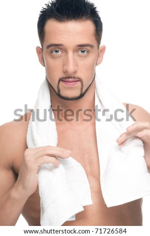 Close up portrait of young handsome man face with perfect skin and towel. Isolated on white - stock photo