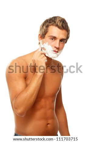 Close up portrait of young handsome man face with perfect skin shaving with foam. - stock photo