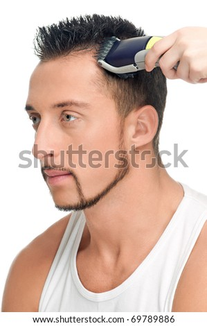 Close up portrait of young handsome man with perfect skin and hair. Cutting hairs. - stock photo