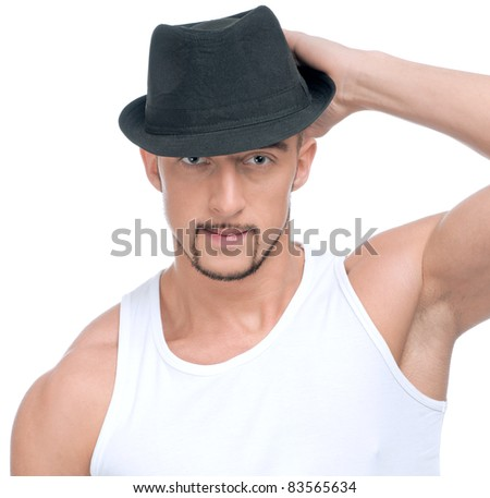 Close up portrait of young handsome man with perfect skin and hair. In black hat - stock photo