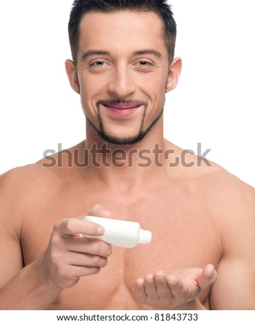 Close up portrait of young handsome man with perfect skin using cream. Isolated on white - stock photo
