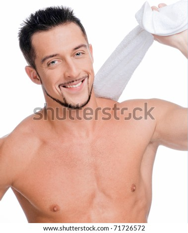 Close up portrait of young happy man face with perfect skin and towel. Isolated on white - stock photo