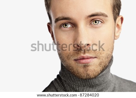 Close-up portrait of young happy man isolated on white background. - stock photo