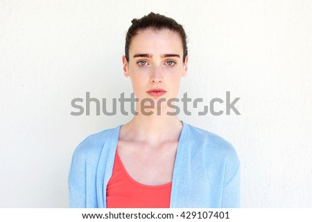 Close up portrait of young healthy woman against white wall - stock photo