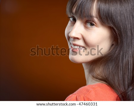 Close-up portrait of young lady with dark shiny hair - stock photo