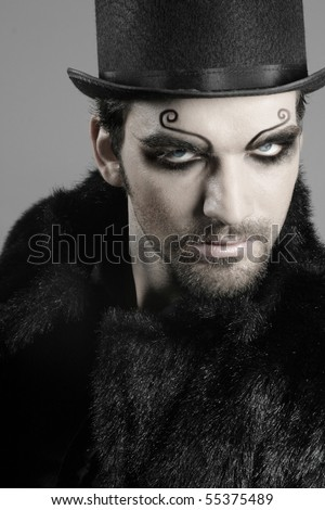 close-up portrait of young male goth model in face makeup